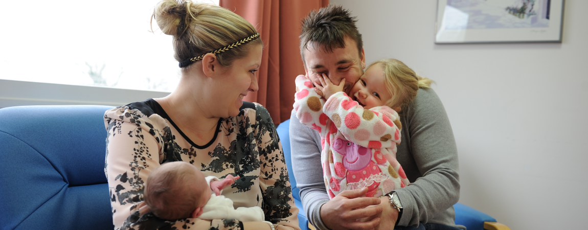 A young family in our maternity unit - Click here to find out more about giving Your Feedback