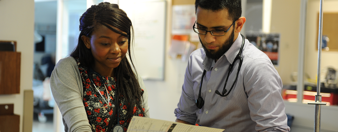 Two clinicans looking at a set of notes - click here to find out more about Inpatient services