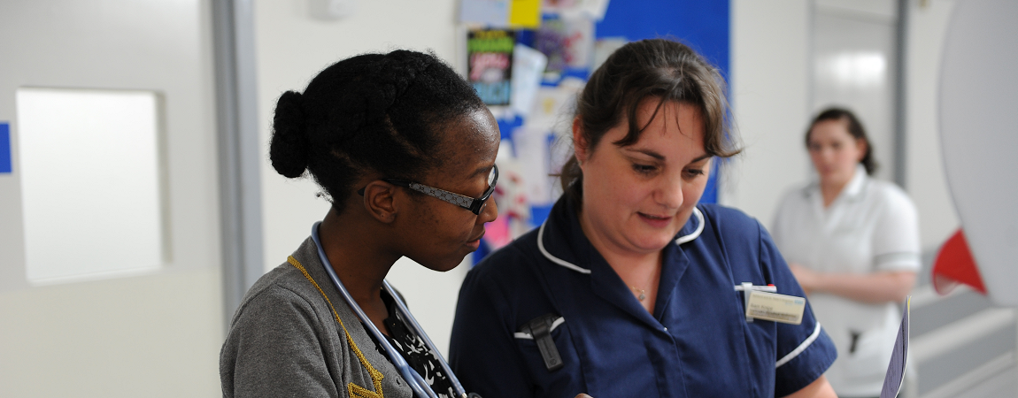 Clinical staff taking in a ward area