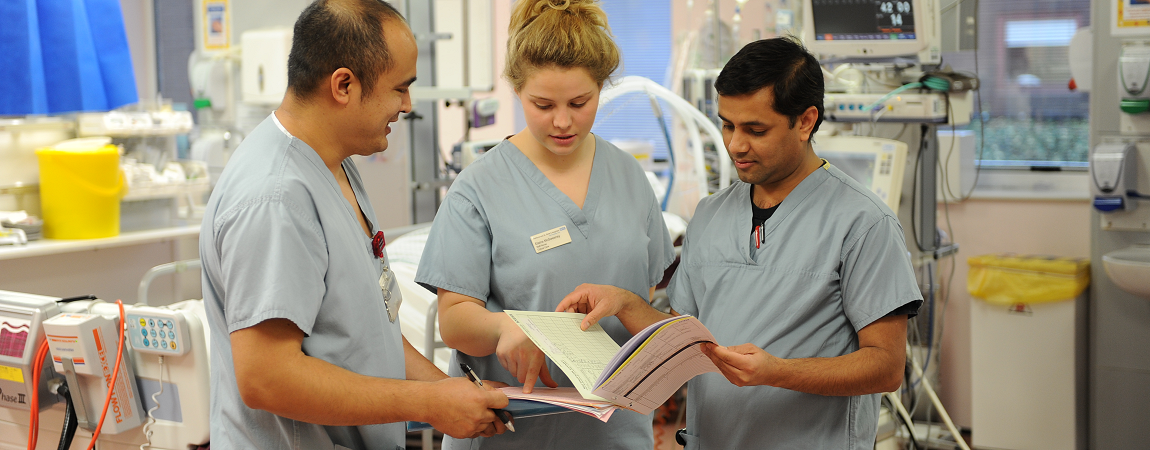 Clinical staff looking at a medical record