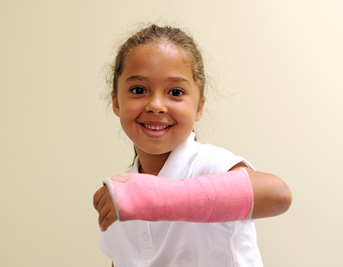 A young patient with lower arm in pink cast