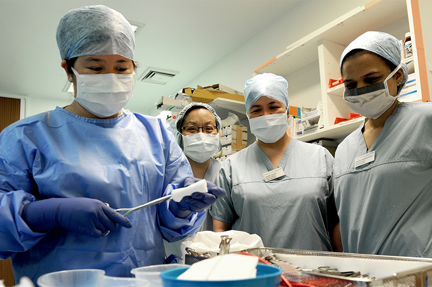 Members of our surgery team prepare instruments for use in theatre